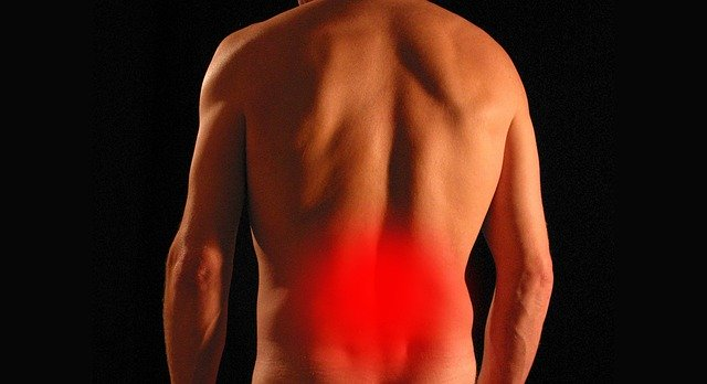 man with red lower back from sciatica