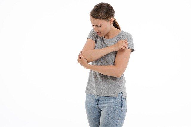 women suffering from elbow pain